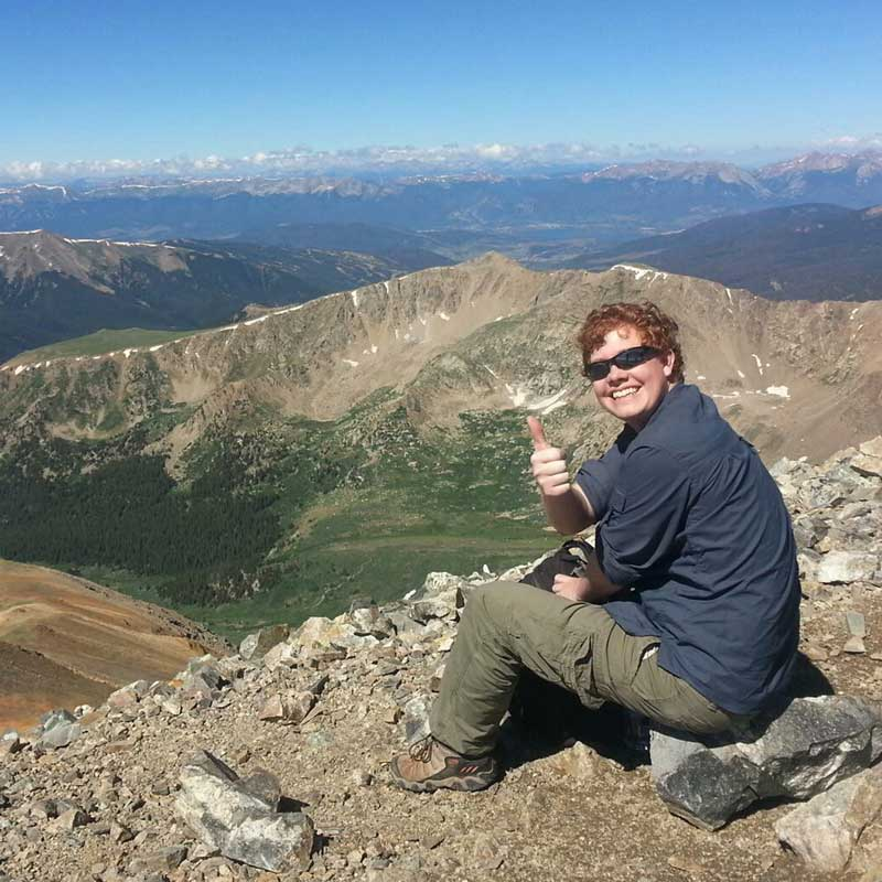 Alex Hyatt smiling while hiking in colorado